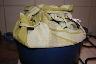 Cover the saucepan lid with a tea towel