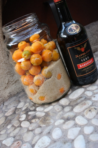 Cumquats, sugar and brandy