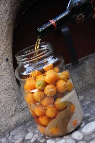 Adding the brandy to cumquats
