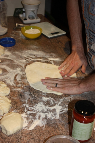 Flatten the dough as far as it lets you take it