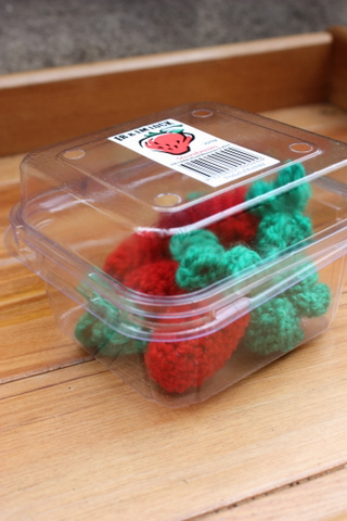 A punnet of crochet strawberries